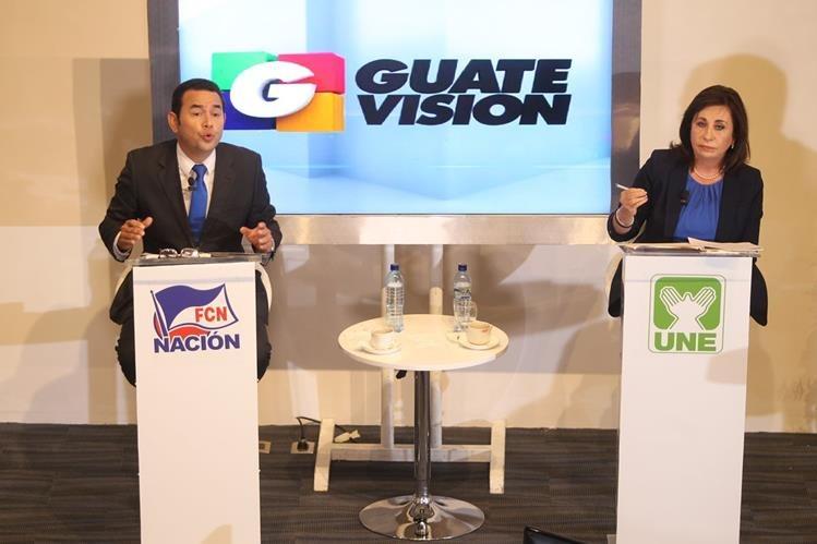 Los presidenciables se aludieron entre sí durante el foro. (Foto Prensa Libre: Esbin García)