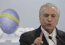 El presidente brasileño volvió a defender hoy su inocencia después de que los directivos de JBS le acusaran de recibir sobornos desde 2010. (Foto Prensa Libre: AP)