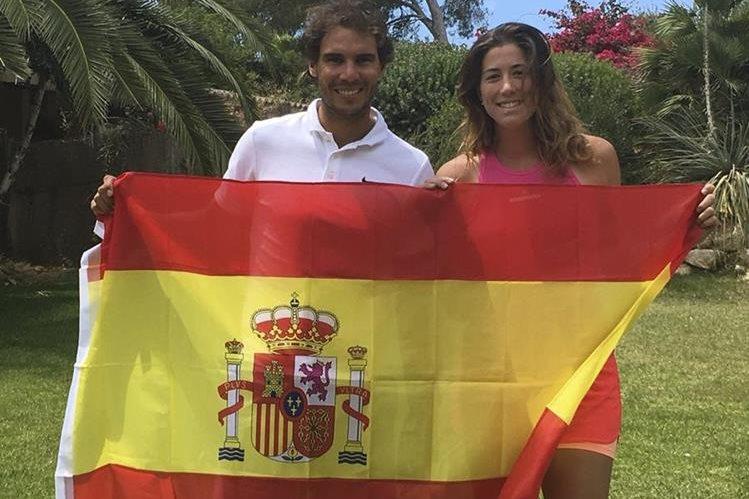 Garbiñe Muguruza junto a Rafael Nadal han llevado a lo más alto del tenis mundial a España. (Foto Prensa Libre: EFE)