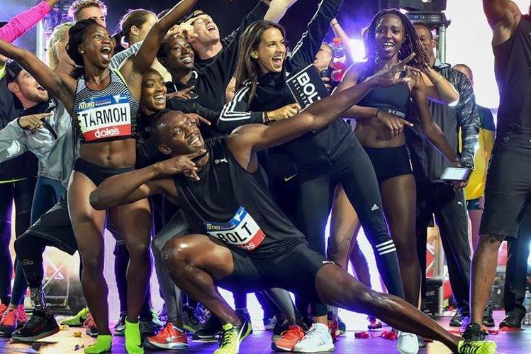 Bolt y su equipo tuvieron una noche de ensueño en Australia. (Foto Prensa Libre: AFP)