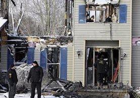 La vivienda donde ocurrió la tragedia quedó destruída. (Foto Prensa Libre: AP).