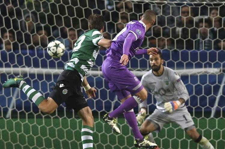 Karim Benzema cabecea y marca el gol del triunfodel Real Madrid en Portugal. (Foto Prensa Libe: AP)