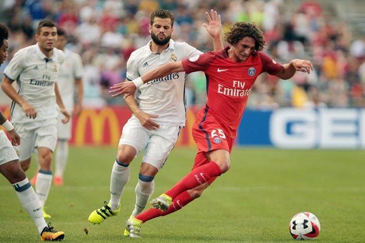 Acción durante el partido entre el Real Madrid y PSG. (Foto Prensa Libre: EFE)