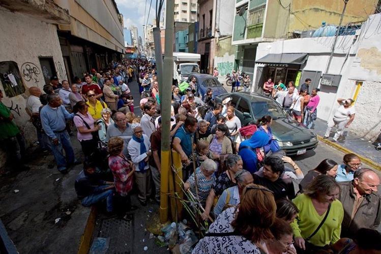 Caracas, la capital venezolana, sufrió en el 2015 119 mil 87 homicidios por cada cien mil habitantes. (Foto Prensa Libre: AP).