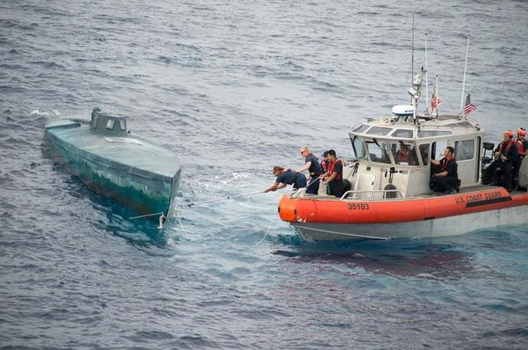 "In this image obtained from the US Coast Guard on August 6, 2015, crew from the Coast Guard Cutter Stratton intercept a self-Propelled Semi Submersible in the Eastern Pacific, on July 18, 2015. The US Coast Guard said it seized $181 million worth of cocaine from a submarine-like vessel in the eastern Pacific Ocean, but even more drugs sank during the bust. The Coast Guard seized 12,000 pounds (5,400 kilograms) of cocaine from four smugglers on a semi-submersible ship, the agency said August 6. The vessel, which was first spotted about 200 miles (320 kilometers) south of Mexico, was carrying a total of 16,000 pounds of narcotics, but as the ship was being towed, it took on water and sank. Some 4,000 pounds of narcotics were lost in the process.    == RESTRICTED TO EDITORIAL USE / MANDATORY CREDIT: ""AFP PHOTO HANDOUT-US COAST GUARD/Petty Officer 2nd Class LaNola Stone""/ NO MARKETING - NO ADVERTISING CAMPAIGNS – NO A LA CARTE SALES / DISTRIBUTED AS A SERVICE TO CLIENTS =="