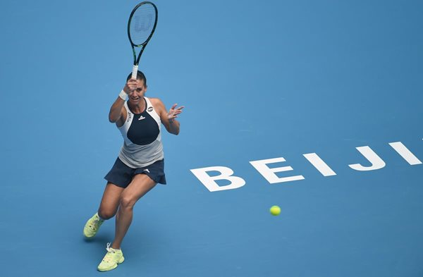 Flavia Pennetta of Italy hits a return against Han Xinyun of China during their women