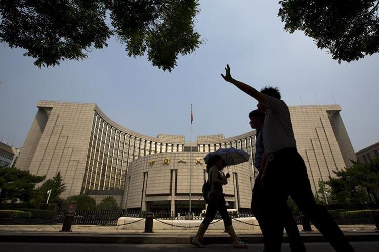 <em>El Gobierno chino propuso este martes que los trabajadores descansen en verano la media jornada de la tarde de los viernes .(Foto Prensa Libre: AP).</em>