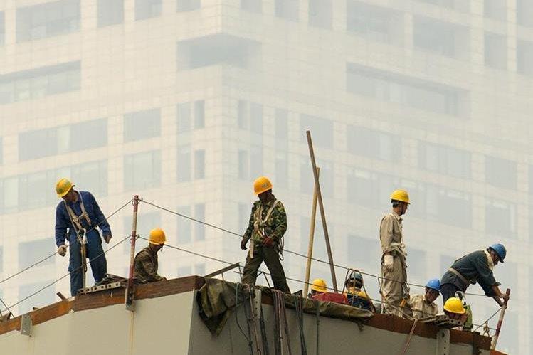 <em>La contaminación atmosférica está provocando la muerte de unas cuatro mil personas al día en China(Foto Prensa Libre: AP).</em>