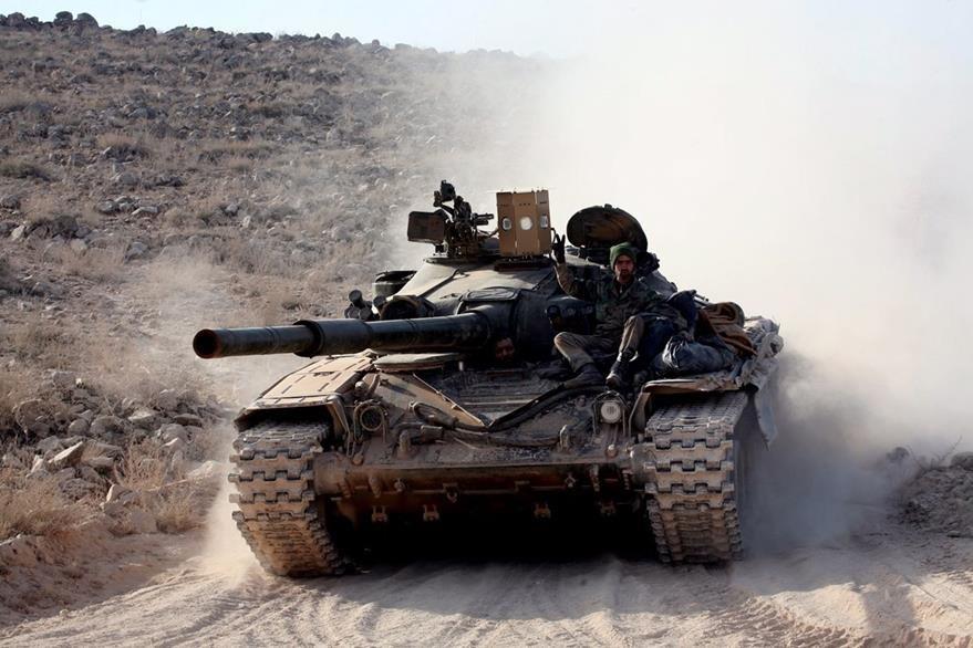 Los tanques del gobierno sirio detuvieron el sábado los ataques por un pacto entre las partes en conflicto. (AFP)