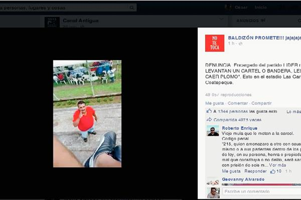 Un hombre vestido de rojo amenaza a opositores de Manuel Baldizón, en Coatepeque, Quetzaltenango. (Foto Prensa Libre: Hemeroteca PL)