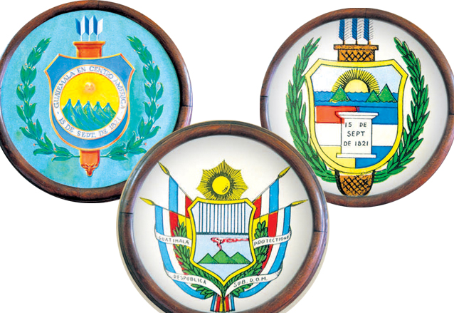 Izquierda, Escudo del Estado de Guatemala de 1843 a 1851. Abajo: primer escudo de la República, de 1851 a 1858. Derecha: segundo escudo de la República, vigente entre 1858 y 1871. (Foto: Hemeroteca PL)