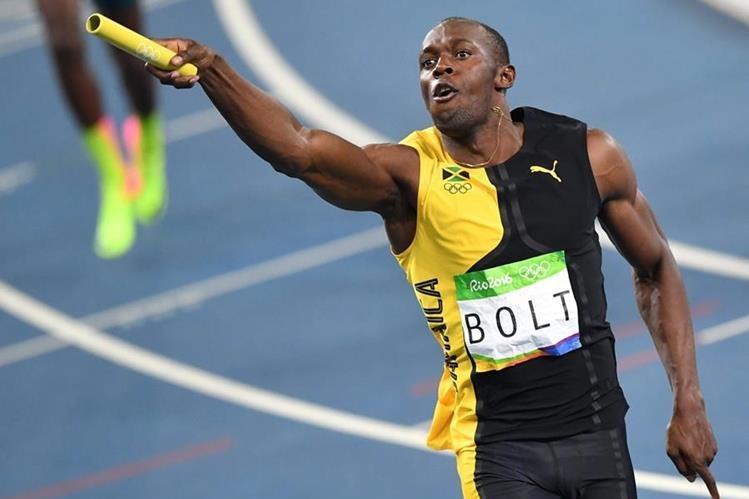 Usain Bolt corrió con gran soltura para asegurar el oro de Jamaica en el relevo 4x100. (Foto Prensa Libre: AFP)