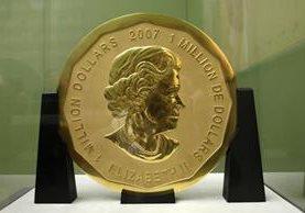 La moneda se encontraba protegida por un cristal antibalas. (Foto Prensa Libre: AFP)