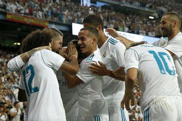 Los jugadores del Real Madrid celebran el gol anotado por Asencio al inicio del partido.