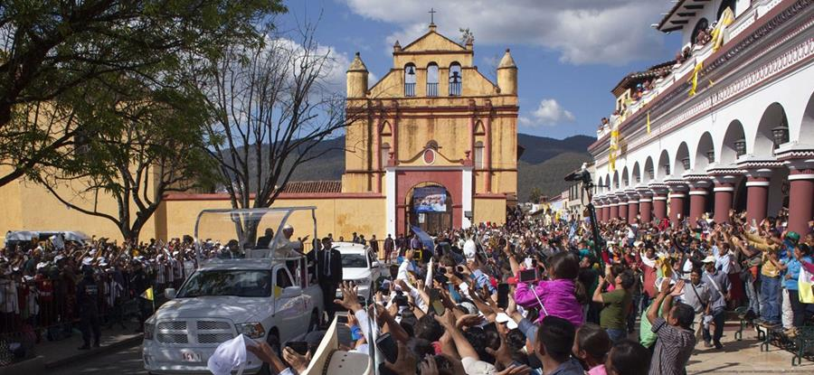 Pope Francis is greeted by the crowd after visiting the main cathedral of San Cristobal de Las Casas, Chiapas State, Mexico, on February 15, 2016. Thousands of indigenous Mexicans flocked on Monday to a field in the impoverished southern state of Chiapas to attend Pope Francis