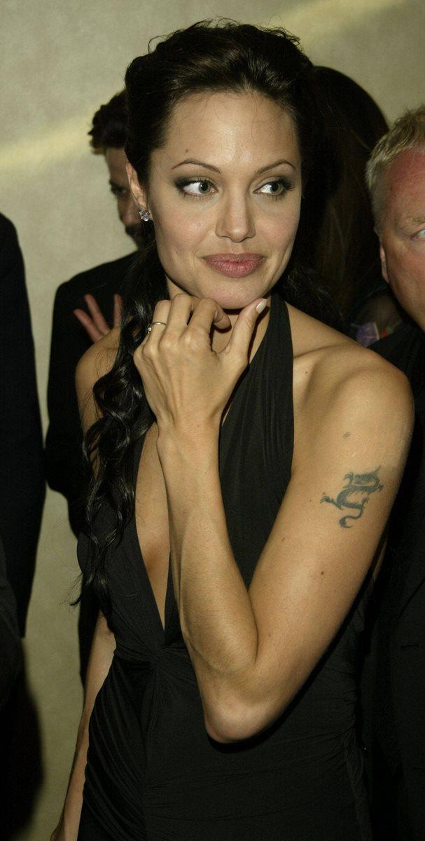La estrella de Hollywood tiene varios grabados en sus brazos. (Foto Prensa Libre: Hemeroteca PL)
