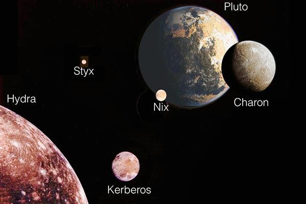 Ilustración proporcionada por la NASA que muestra a Plutón y sus cinco lunas. (Foto Prensa Libre: AP).