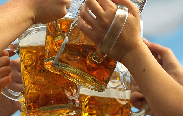 Visitors toast with beer mugs in a Oktoberfest festival tent at the Theresienwiese in Munich, October 4, 2010. After more than two weeks the world
