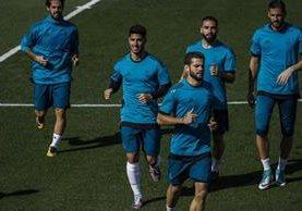 Marco Asensio entrenó ayer junto al resto de sus compañeros, pero quedó fuera de la convocatoria. (Foto Prensa Libre: EFE)