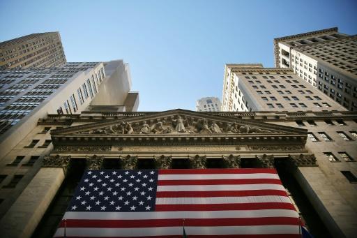 Los inversionistas este día están más interesados en las fiestas de fin de año que en la bolsa de valores. (Foto Prensa Libre: AFP)