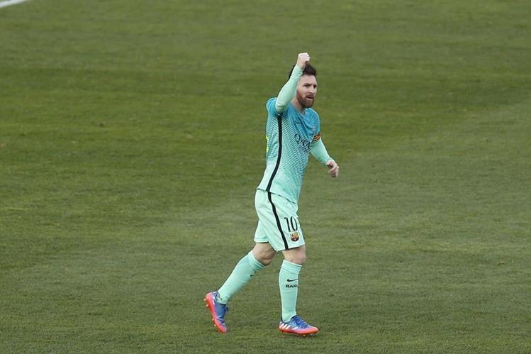 Messi festeja luego de su anotación frente al Atlético de Madrid. (Foto Prensa Libre: AP)