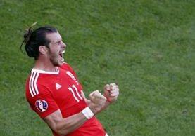Gareth Bale asegura que los jugadores de Gales disfrutan más el futbol que los ingleses. (Foto Prensa Libre: EFE)