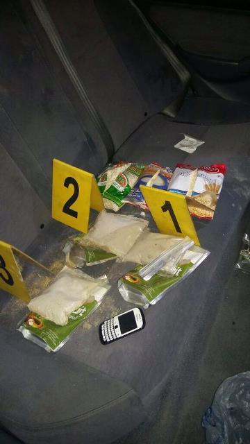 Los investigadores encontraron la heroína ocultan en empaques de cereales. (Foto Prensa Libre: PNC)