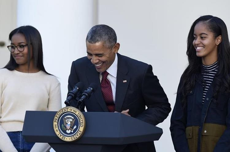 President Barack Obama, with daughters, Sasha, left, and Malia, laughs as he talks about pardoning the National Thanksgiving Turkey Abe, Wednesday, Nov. 25, 2015, during a ceremony in the Rose Garden of the White House in Washington. This is the 68th anniversary of the National Thanksgiving Turkey presentation (AP Photo/Susan Walsh)