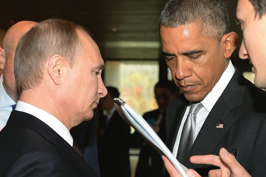 FILE _ This is a Tuesday, Nov. 11, 2014 file photo of Russian President Vladimir Putin, left, and U.S. President Barack Obama, as they talk on the sidelines of the Asia-Pacific Economic Cooperation (APEC) Summit  in Beijing.  Vladimir Putin