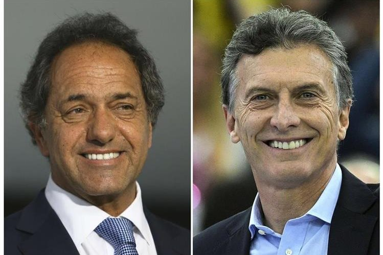 Daniel Scioli y Mauricio Macri, punteros en la encuestas. (Foto Prensa Libre: AFP).