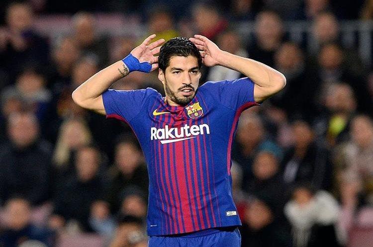 Luis Suárez reacciona durante el partido que el Barcelona recibió al Sporting.