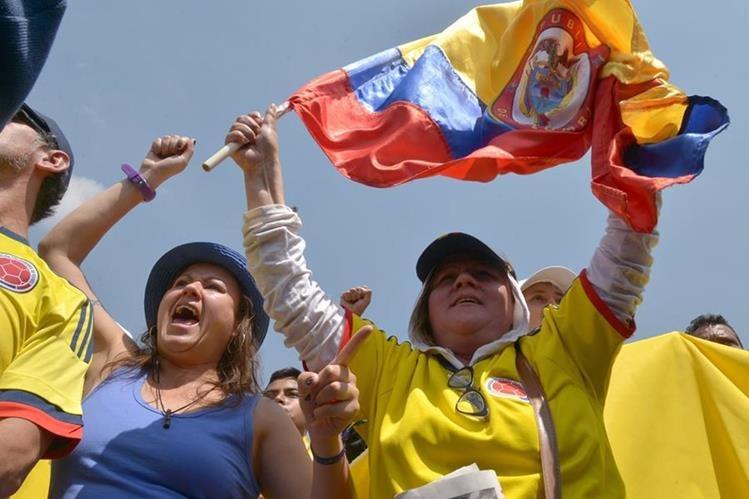 Cientos de colombianos protestan en Bogotá contra políticas económicas de Juan Manuel Santos. (Foto PL: AFP)