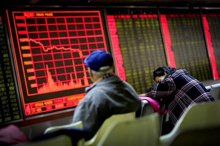 Las acciones estadounidenses iniciaron el 2016 con un tono adusto, luego de una caída en las bolsas de China y Europa. (Foto Prensa Libre: AP)
