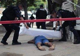 <em>El cadáver quedó en una concurrida área de turistas. (Foto Prensa Libre: AFP).</em>