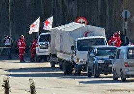 El personal de la Cruz Roja Internacional y de la Media Luna Roja trabajan en Oriente Medio.(AFP)