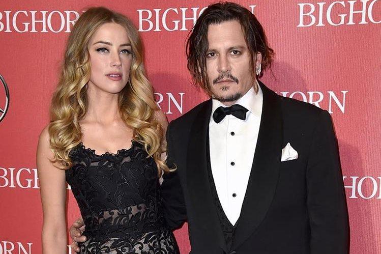 Amber Heard y Johnny Depp hacen las pases para divorciarse. (Foto Prensa Libre: AP)