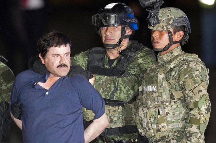 "In this Friday, Jan. 8, 2016 photo, Joaquin ""El Chapo"" Guzman is made to face the press as he"