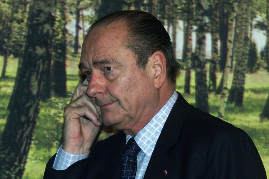 (FILES) - A picture taken on March 24, 2001 in Stockholm shows then French President Jacques Chirac talking  on the phone on the second day of a two-day European Union summit. Documents published online by WikiLeaks on June 23, 2015 indicates that the US spyed on French presidents Jacques Chirac, Nicolas Sarkozy and Hollande from 2006 to 2012. AFP PHOTO