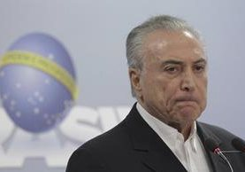 Escándalos por corrupción rodean a Michel Temer en Brasil. (Foto Prensa Libre: AP)