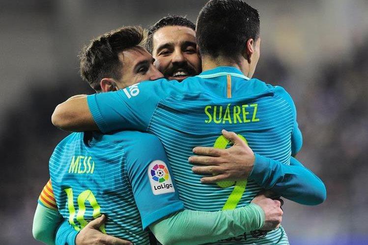 Messi y Suárez fueron fundamentales en la goleada azulgrana. (Foto Prensa Libre: AFP)