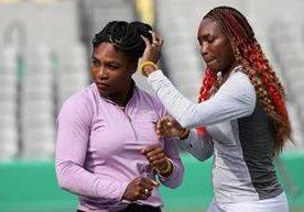 Las hermanas comparten en el trabajo olímpico.