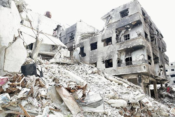 Destrozo en campo de refugiados en Damasco. (Foto Prensa Libre EFE)