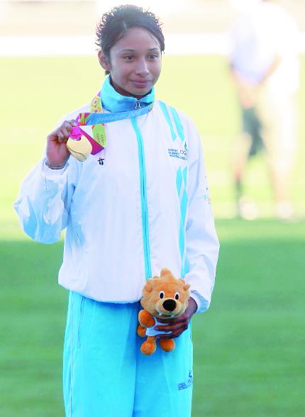 Jamy Franco en la premiaciÛn de la medalla de oro luego que el domingo se coronara en los 20 kilÛmetros marcha. (Foto Prensa Libre: Fernando LÛpez R.)
