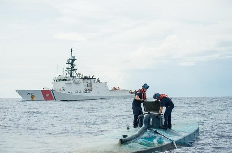 "In this image obtained from the US Coast Guard on August 6, 2015, a Coast Guard Cutter Stratton boarding team opens the bridge of a self-propelled semi-submersible intercepted in international waters off the coast of Central America, July 19, 2015. The US Coast Guard said it seized $181 million worth of cocaine from a submarine-like vessel in the eastern Pacific Ocean, but even more drugs sank during the bust. The Coast Guard seized 12,000 pounds (5,400 kilograms) of cocaine from four smugglers on a semi-submersible ship, the agency said August 6. The vessel, which was first spotted about 200 miles (320 kilometers) south of Mexico, was carrying a total of 16,000 pounds of narcotics, but as the ship was being towed, it took on water and sank. Some 4,000 pounds of narcotics were lost in the process.   == RESTRICTED TO EDITORIAL USE / MANDATORY CREDIT: ""AFP PHOTO HANDOUT-US COAST GUARD/Petty Officer 2nd Class LaNola Stone""/ NO MARKETING - NO ADVERTISING CAMPAIGNS – NO A LA CARTE SALES / DISTRIBUTED AS A SERVICE TO CLIENTS =="
