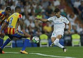 Asensio se vistió de Cristiano y salvó un punto valioso para el Real Madrid. (Foto Prensa Libre: AP)