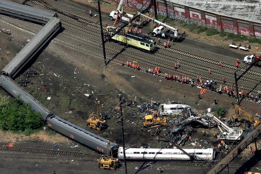 PHILADELPHIA, PA - MAY 13: Investigators and first responders work near the wreckage of an Amtrak passenger train carrying more than 200 passengers from Washington, DC to New York that derailed late last night May 13, 2015 in north Philadelphia, Pennsylvania. At least five people were killed and more than 50 others were injured in the crash.   Win McNamee/Getty Images/AFP  == FOR NEWSPAPERS, INTERNET, TELCOS & TELEVISION USE ONLY ==