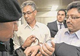 Carlos Muños y Omar Franco, exjefes de la Superintendencia de Administración Tributaria, son vinculados a la investigación contra la red <em>La Líneas</em>. (Foto Prensa Libre: Hemeroteca)