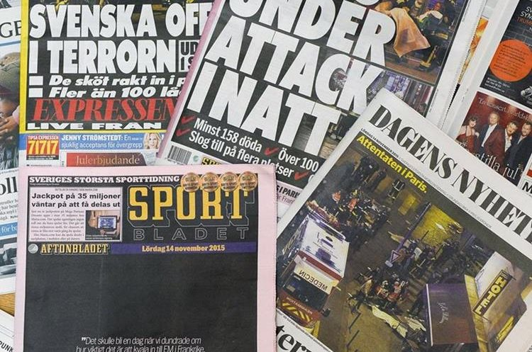 The front pages of some of Sweden's daily newspapers showing pictures and headlines from the attacks in Paris are pictured in Stockholm, on November 14, 2015.  The string of coordinated attacks in and around Paris late November 13, 2015 left more than 120 people dead, in the worst such violence in France