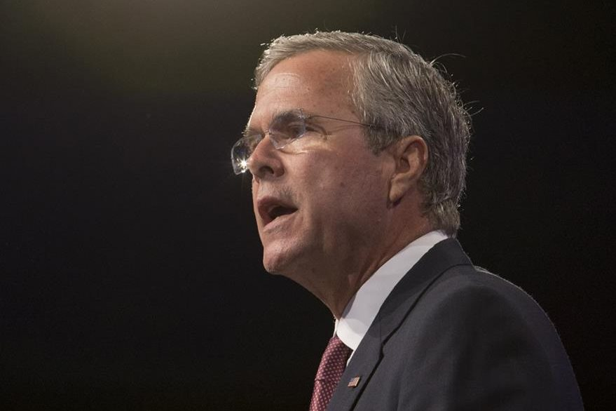 In this photo taken July 31, 2015, Republican presidential candidate, former Florida Gov. Jeb Bush speak in Fort Lauderdale, Fla. Ten Republican presidential hopefuls face off in the first prime-time debate of the 2016 campaign Thursday night in a clash that marks a big step forward in their quest for the nomination. (AP Photo/Wilfredo Lee)