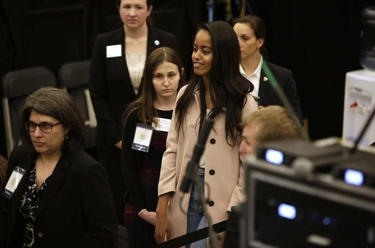 CHICAGO, ILLINOIS - APRIL 07: Malia Obama, right, daughter of President Barack Obama attends her father